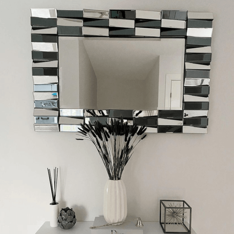 A gorgeous two-tone mirror complements this monochrome themed console table