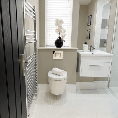 We love the cool, understated styling in the downstairs bathroom, which is mostly used by Shannen's salon clients. The perfect professional touch.