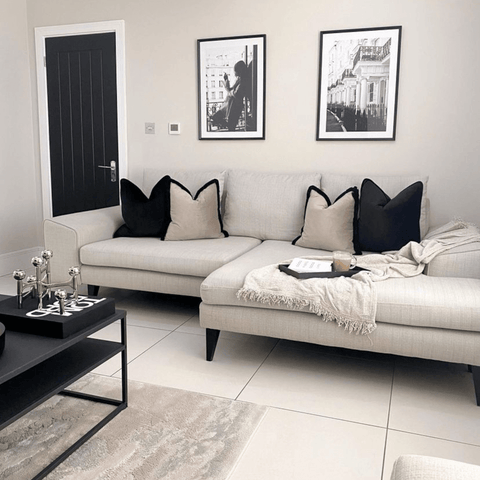 Soft neutrals contrast beautifully with matte black and white in the super chic living area.