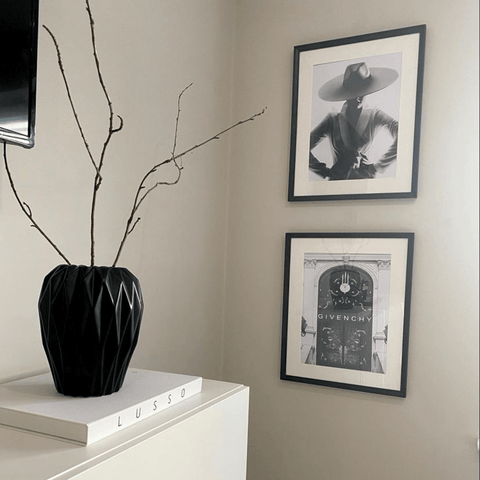 Stylish black and white prints are dotted on walls all around the home.