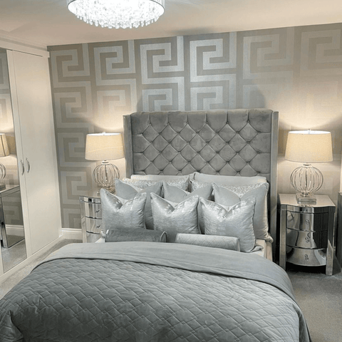 In the super glamorous bedroom, silver upholstery and reflective surfaces create lots of light and space.