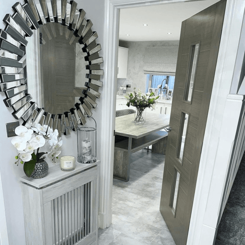 A hallway that's enhanced by a gorgeous statement wall mirror
