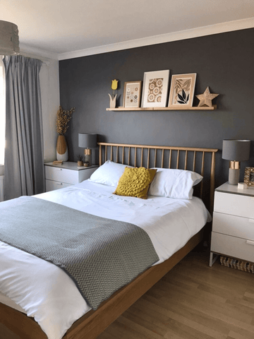 Adding a dark grey feature wall gives  a bold, contemporary feel, as in this bedroom by @our_family_at_tulip_house