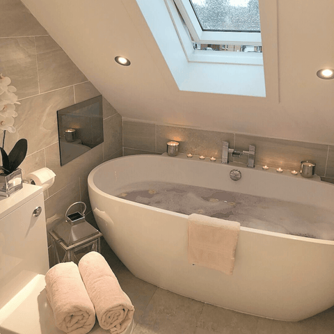What could look more inviting than a candlelit bathtub under a skylight? Other than Hampton and Astley's irresistibly soft Egyptian cotton towels in blush pink