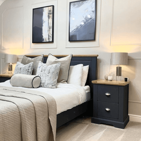 Dark painted wood furniture makes a bold statement in the master bedroom, contrasting perfectly with the neutral paneled walls.