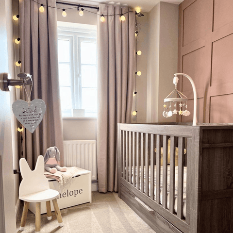 There's more paneling in daughter Penelope's room, but this time in beautiful blush pink to match the soft furnishings.