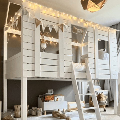 This fabulous loft bed is the stuff of every child's dreams, complete with twinkly fairy lights laced around the top.