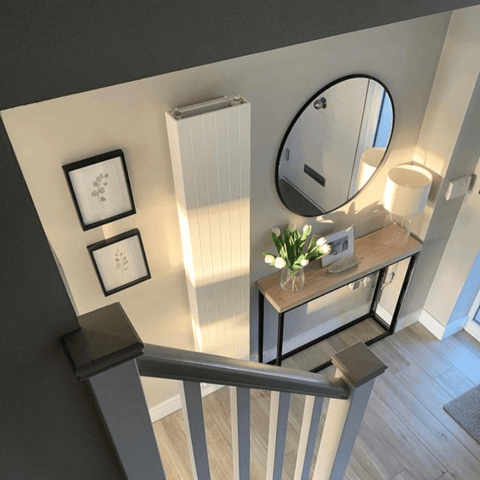 Adding a vertical designer radiator makes all the difference in rooms with limited space, such as in this gorgeous entrance hallway