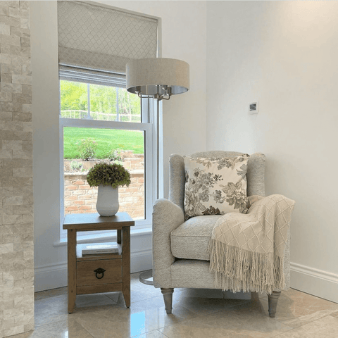 This cosy corner has a perfect view of the beautiful landscape that surrounds the home, providing an ideal spot to while away the hours.