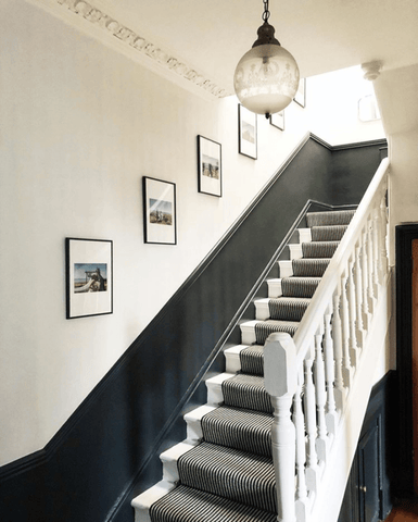 A striking monochrome colour scheme lights up the hallway and stairs