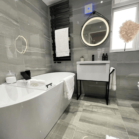 While the bathroom features a chic free-standing tub and a set of Hampton and Astley indulgently thick Egyptian cotton towels.