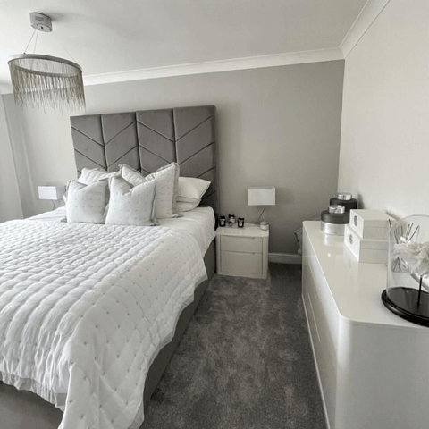 Soft greys and white blend together in the very restful looking master bedroom.