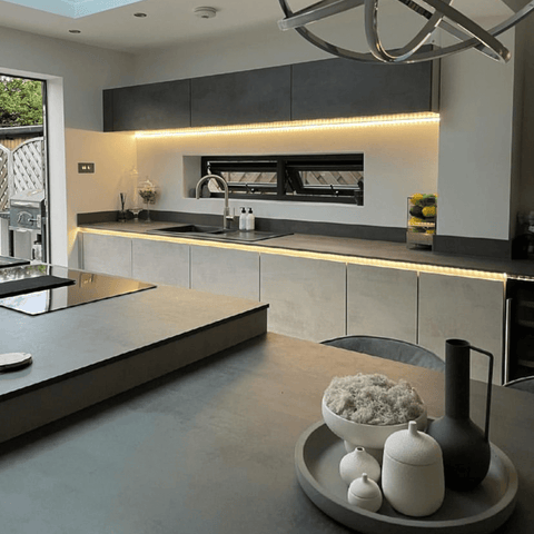 Creating plenty of room for the spacious matte grey kitchen.