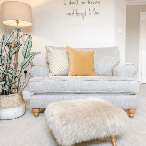 Warm toned fabrics and a gorgeous faux fur footstool create a cosy vibe in the lounge