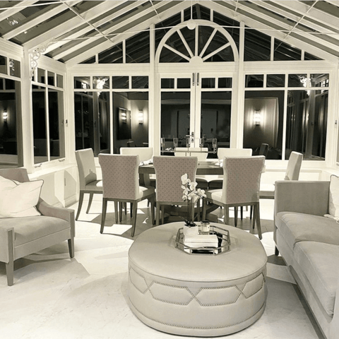 A beautiful conservatory lounge and dining area