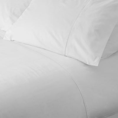 Matching piping detail on pillowcases and duvet cover