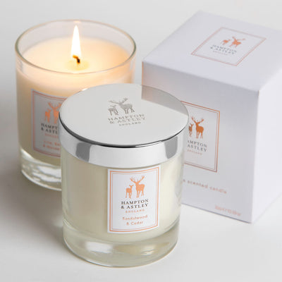 Sandalwood and Cedar Luxury Scented Candle with an included textured white gift box.