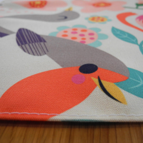 Close up of Bright Birds Apron by Rollerdog