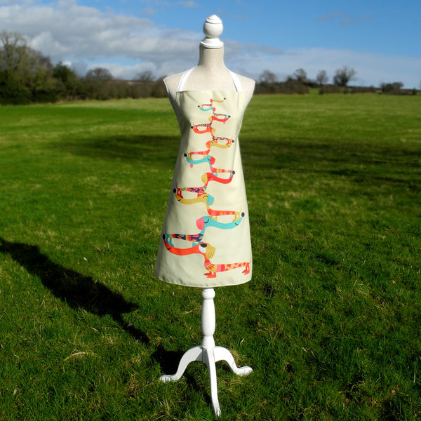 Dashing Dachshunds apron in cream by Rollerdog