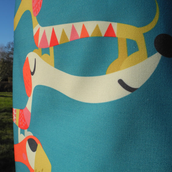 Detail of Dashing Dachshunds apron by Rollerdog