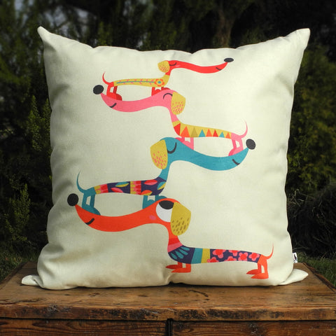 Dashing Dachshunds cushion by Rollerdog