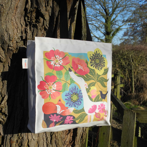 A Dog Rose tote bag by Rollerdog, showing it outside in the sunshine