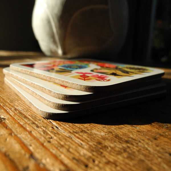A stack of 4 coasters featuring the Dog Rose design by Rollerdog