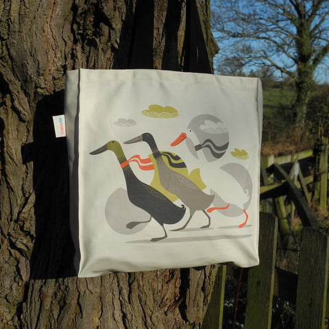 A Three Ducks from Derbyshire tote bag by Rollerdog, shown outside in the sunshine