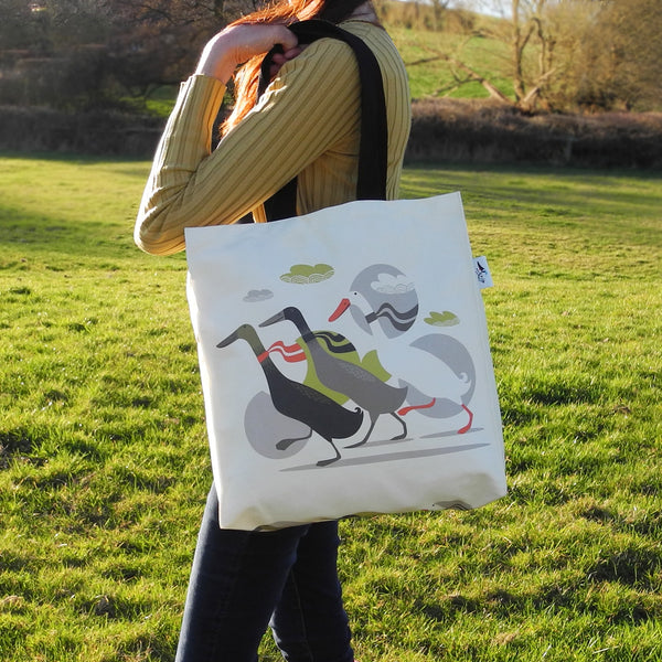 A Three Ducks from Derbyshire tote bag by Rollerdog, shown in use as a shoulder bag