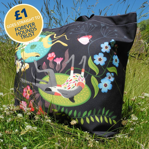 Forever Hounds Trust tote bag, outside in the sun, with £1 going to Forever Hounds Trust