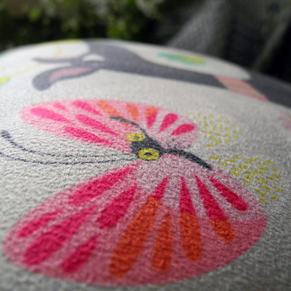 Close up view of a Freddie the Tripod cushion by Rollerdog