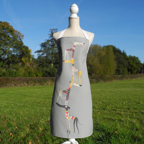A Graceful Greyhounds apron by Rollerdog, shown on a mannequin in the countryside