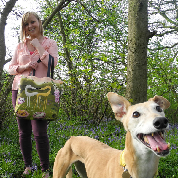 Hounds of Love tote bag being modelled with a greyhound