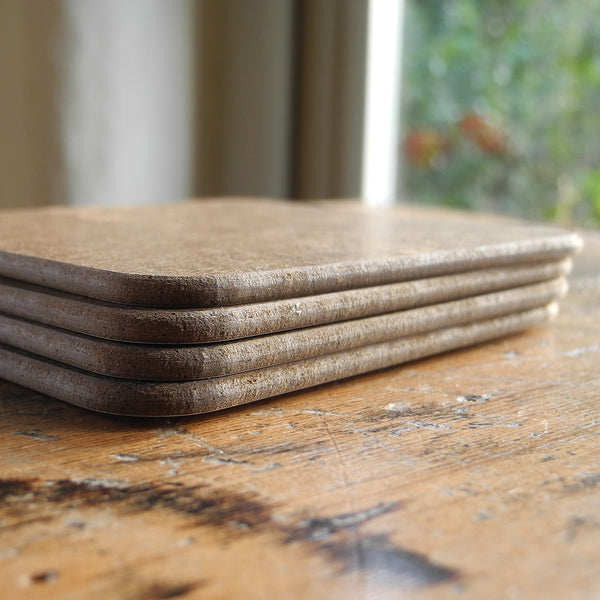 A stack of Rollerdog coasters, showing the underside