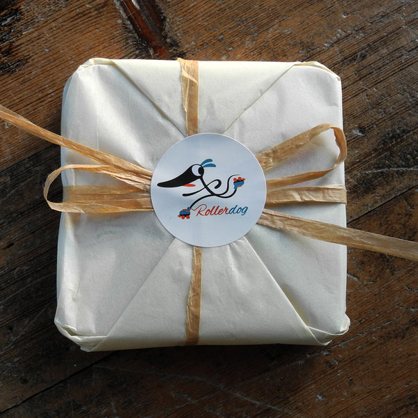 A set of wrapped Rollerdog coasters