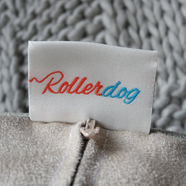 The zip and the back of a label on a Rollerdog cushion