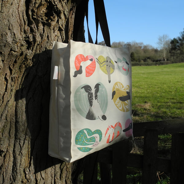 Side view of a Noses and Poses tote bag by Rollerdog