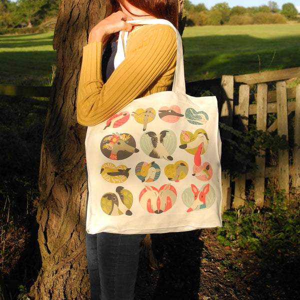 A Noses and Poses tote bag by Rollerdog, shown in use as a shoulder bag