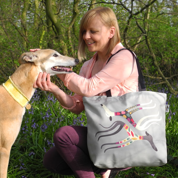 Front of the Rollerdog Sleepy Sighthounds tote with human and canine models