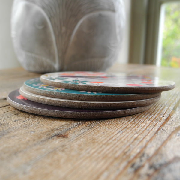 A stack of 4 Forever Hounds Trust coasters