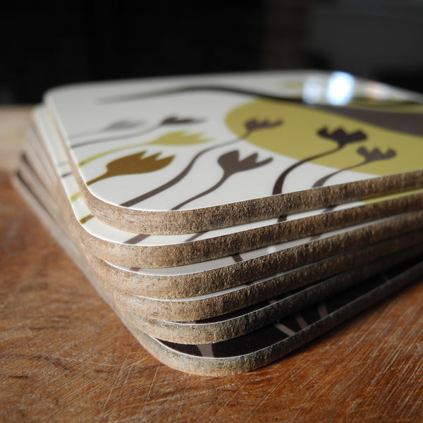 A stack of Rollerdog duck coasters, showing the thickness and material of the coasters