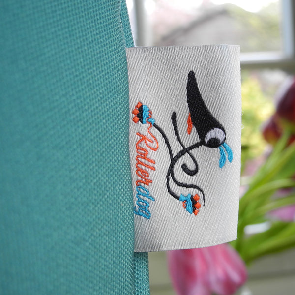 Close up of the Rollerdog tag on the Snowy the Whippet tote bag