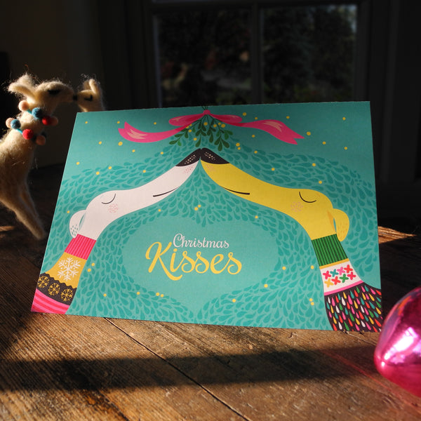 Christmas Kisses Christmas card by Rollerdog