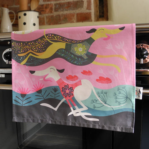 Zoomies tea towel in the kitchen by Rollerdog