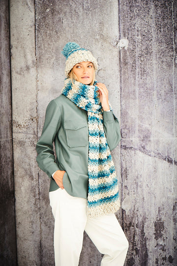 Striped bobble hat and long scarf. Both striped with a pale cream, light and darker blue.
