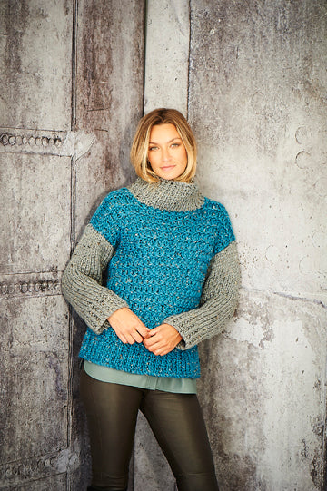 Bold blue and dark putty grey women's sweater with a high neck.