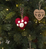 Hanging red heart ornament with a large white paw print. Approximately 10cm wide.