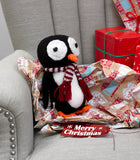 Adorable penguin toy with a red and white striped scarf. Approximately 20cm tall.