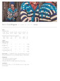 Ari cardigan. A cardigan with white and navy blue stripes with thin yellow lines. Over top, a teal blue nordic swirl pattern over the chest and back. A blue teal trim is on the cuffs and collar of the cardigan.