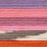 Variegated yarn containing purples, pinks, grey and white, and orange